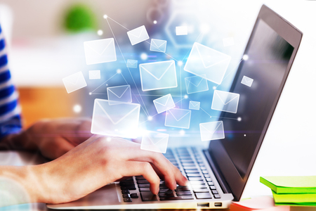 Photo pour Hands using laptop with abstract email interface. E-mail networking concept. 3D Rendering  - image libre de droit