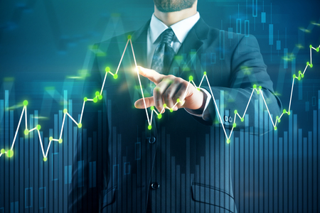 Photo pour Businessman pointing at business chart on blurry background. Trade and management concept. Double exposure - image libre de droit