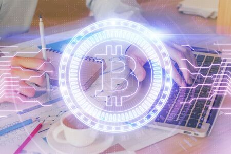 Photo for Crypto currency theme hologram with businessman working on computer on background. Concept of blockchain. Double exposure. - Royalty Free Image