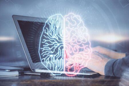 Foto de Man typing on keyboard background with brain hologram. Concept of big Data. Double exposure. - Imagen libre de derechos