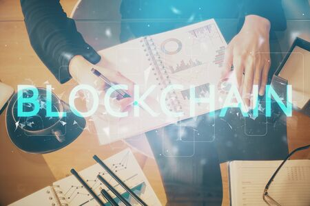 Photo for Cryptocurrency hologram over woman's hands writing background. Concept of blockchain. Double exposure - Royalty Free Image