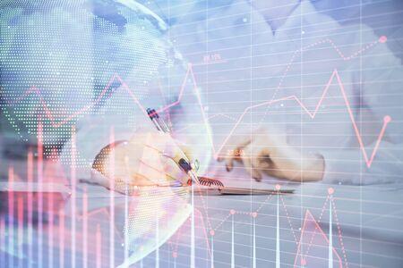 Foto de Financial chart drawn over hands taking notes background. Concept of research. Multi exposure - Imagen libre de derechos
