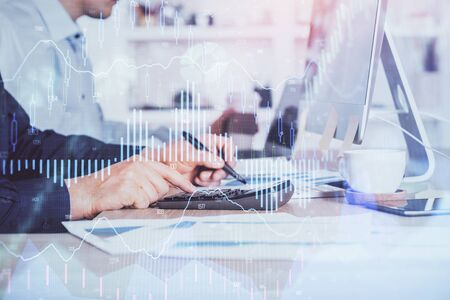 Foto de Forex graph with businessman working on computer in office on background. Concept of hardworking. Closeup. Multi exposure. - Imagen libre de derechos