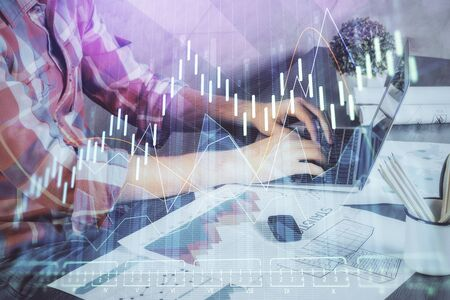 Photo for Double exposure of stock graph with businessman typing on computer in office on background. Concept of hard work. - Royalty Free Image