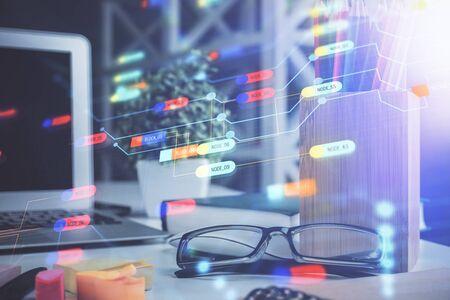 Foto de Data tech hologram with glasses on the table background. Concept of technology. Double exposure. - Imagen libre de derechos