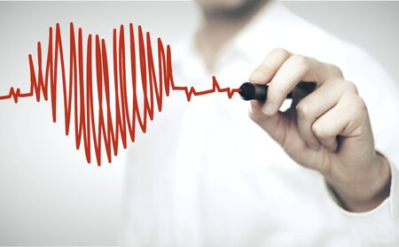 Foto de Doctor drawing red heart symbol and chart heartbeat. Healthcare and medical concept - Imagen libre de derechos