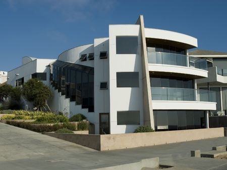 Ultra modern contemporary white house with balconies and landscaping