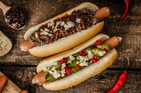 Photo for Chilli and vegetarian hot dog, home pickles, beef meat and homemade barbeque souce - Royalty Free Image
