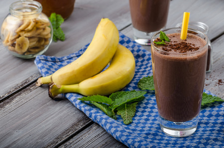 Photo for Chocolate-banana smoothie, 70 % cocoa, all natural ingredience - Royalty Free Image