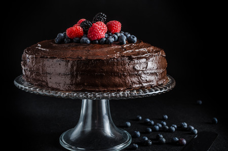 Photo pour Three flour chocolate cake with, without berries - image libre de droit