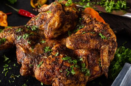 Photo for Bio chicken with spicy peppers, habanero and trinidad scorpion and lots of herbs - Royalty Free Image