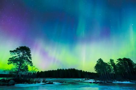 Photo pour Colorful Northern lights Aurora borealis in the sky - image libre de droit
