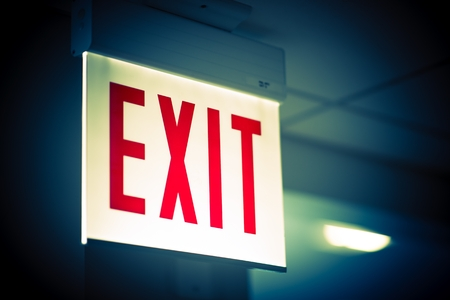 Photo pour Illuminated Corporate Office Exit Sign Closeup. - image libre de droit