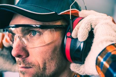 Photo pour Worker Protection Equipment. Hearing Protectors and Glasses. - image libre de droit