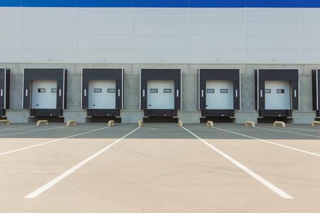 Foto de Storage entrances, new large warehouse - Imagen libre de derechos