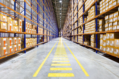 Photo for Rows of shelves with boxes in modern warehouse - Royalty Free Image