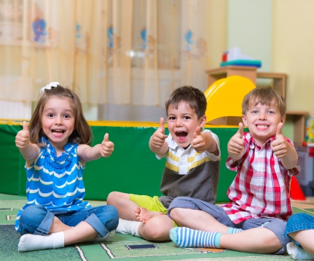 Photo for Group of excited children holding thumbs up - Royalty Free Image