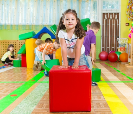 Photo for Cute children playing in kindergarten gym - Royalty Free Image