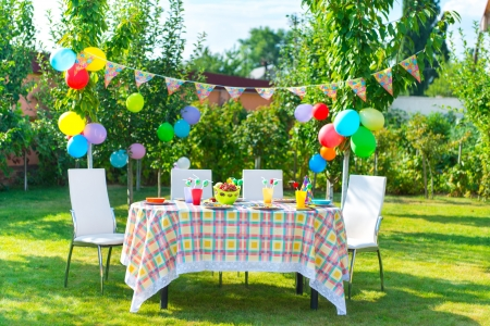 Photo for Prepared birthday table in summer green garden - Royalty Free Image