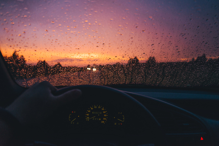 Photo for Rain drop on the car glass background with red sunset - Royalty Free Image