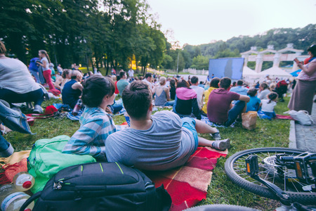 Photo for people watching movie in open air cinema in city park - Royalty Free Image