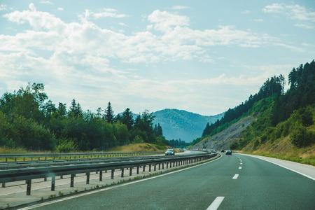 Photo pour summer time road trip. speedway in mountains. car travel - image libre de droit