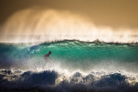 Photo for Surfer on Blue Ocean Wave in Bali, Indonesia. Focus on foreground - Royalty Free Image