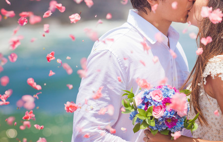 Foto de wedding couple just married with bridal bouquet - Imagen libre de derechos