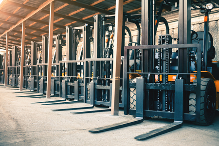 Foto per Background of a lot of forklifts, reliable heavy loader, truck - Immagine Royalty Free