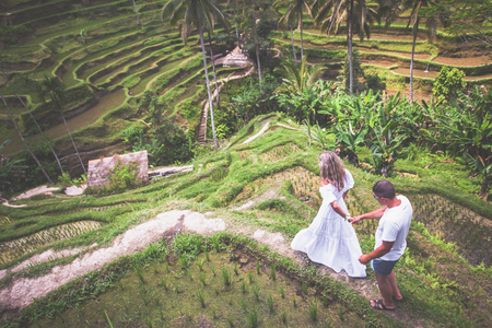 Photo for Happy couple traveling at Bali, rice terraces of Tegalalang, Ubud - Royalty Free Image