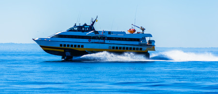 Photo for hydrofoil boat runs at full speed on the sea waves - Royalty Free Image