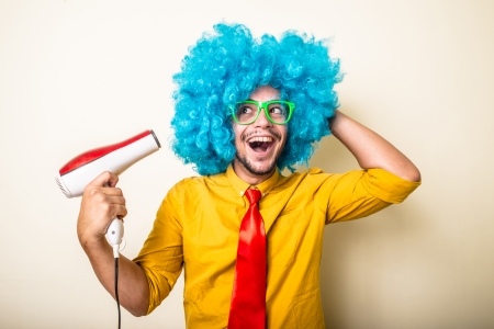 Foto de crazy funny young man with blue wig on white background - Imagen libre de derechos