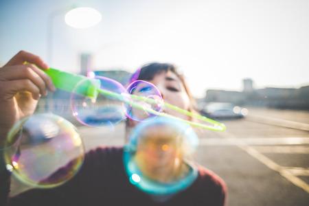 Foto de young beautiful hipster woman bubble blower in the city - Imagen libre de derechos