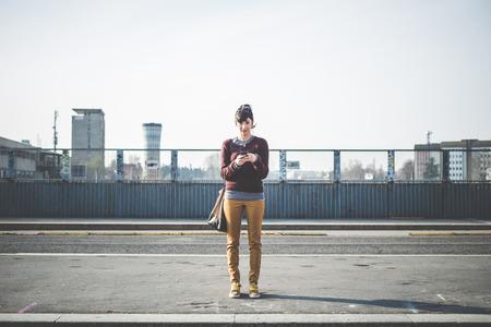 Foto de young beautiful hipster woman using smart phone in the city - Imagen libre de derechos
