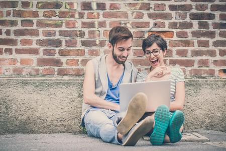 Photo for couple of friends young  man and woman using laptop in the city - Royalty Free Image