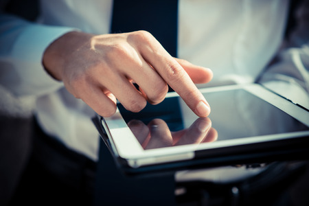 Foto de close up businessman man hand using tablet device outdoor - Imagen libre de derechos
