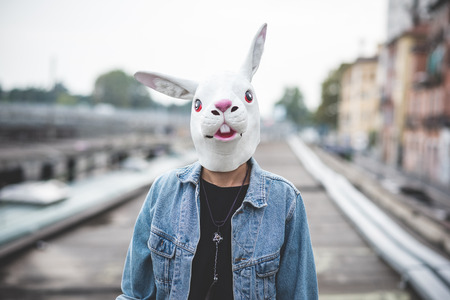 Photo for rabbit mask young handsome bearded hipster man in the city - Royalty Free Image
