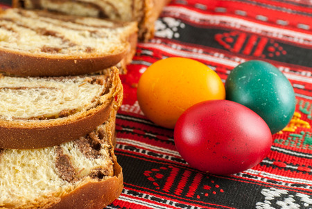 Photo for traditional orthodox sponge cake and colored easter eggs - Royalty Free Image