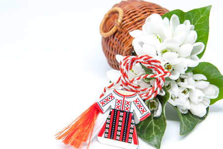 Foto de snowdrops and red and white string martisor on white with copy space east european first of march tradition celebration - Imagen libre de derechos