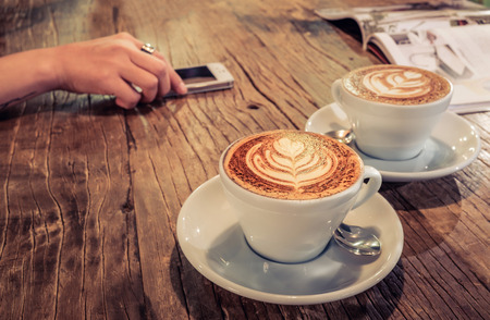 Photo for cup of coffee on table in cafe. - Royalty Free Image