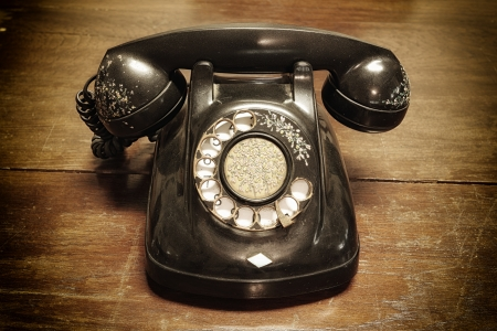 Photo for old telephone with rotary dial on old wooden - Royalty Free Image