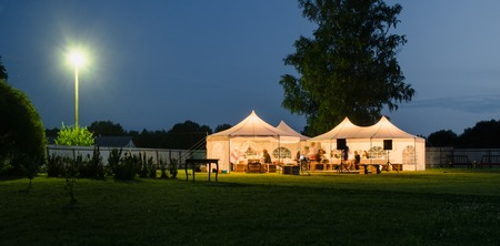 Photo for Wedding tent on the lawn at night - Royalty Free Image