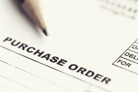 Photo pour Macro Purchase order with pencil - image libre de droit