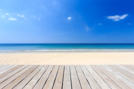 Photo for Close up wooden decking or flooring and tropical beach - Royalty Free Image