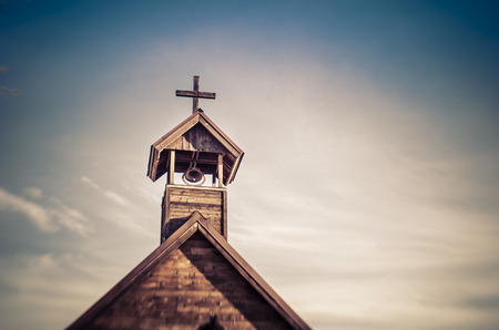 Photo pour Old church steeple with bell - sky background add copy - image libre de droit