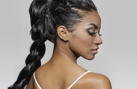 Foto de Braided hair side profile exotic young woman - Imagen libre de derechos