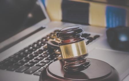 Foto de Law legal concept photo of gavel on computer with legal books in background. - Imagen libre de derechos