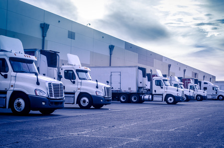 Photo pour Trucks lorries loading unloading depot warehouse - image libre de droit