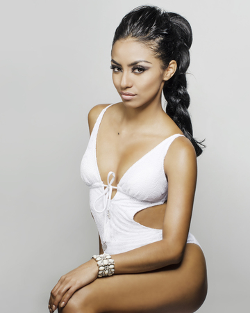 Photo for Beautiful exotic young wearing swimsuit - Royalty Free Image