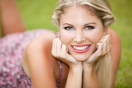 Beautiful youn woman sitting in the grass